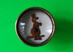 VINTAGE  GUINNESS ADVERT INTEGRAL GLASS BUTTON ,A KANGAROO,BOTTLE IN POUCH