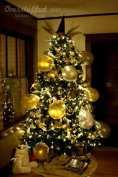 Fun idea for New Year's Eve. Redecorate the Christmas tree and fill balloons with activities for the kids to do all day on New Year's Eve. #overstuffedlife
