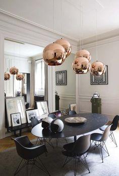 Elegant dining area, pendants by Tom Dixon. Via Côté Maison. Photo by Jean-Marc Palisse.