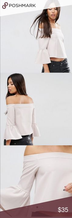 ASOS Off The Shoulder Top with Ruffle Sleeve WHITE PRODUCT DETAILS Top by ASOS Collection Stretch woven fabric Bardot neckline Off-the-shoulder design Fluted sleeves Regular fit - true to size Machine wash 89% Polyester, 11% Elastane Our model wears a UK 8/EU 36/US 4 ASOS Tops Blouses