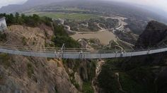 China has just opened its first glass-bottomed suspension bridge, and being nearly 600-feet-high and 1,000-feet-long, it definitely isn't for the faint of heart.