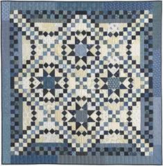 """Savannah - Stellar Quilts, 2009. Designed and pieced by Judy Martin. Quilted by Margy Sieck. 58"""" x 58"""". Alternate sizes of 78"""" x 102"""" and 105"""" x 105"""" also presented."""