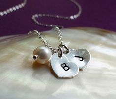 Two Hearts Necklace, Two initials necklace, personalized necklace, couples initials, Sisters, husband wife, best friends, mothers necklace. $29.00, via Etsy.