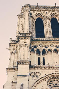 A closeup of one of the towers of the Notre Dame de Paris in France. Vertical photograph, pastel colors.  #paris #notredame #architecture #photography