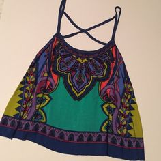 Patterned Crop Top ••LIKE NEW•• Multicolored patterned crop top! Cross cross detailing across back. Great with high waisted shorts! •Make me an offer! Anything is negotiable!• listed as Zara for exposure. Zara Tops Crop Tops