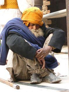 Sleeping man in Old Dehli by colleenmarples, via Flickr