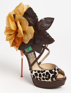 "Jimmy Choo is introducing this super slim and sleek heel sandal called ""Mira Flower"" from his spring 2012 collection."