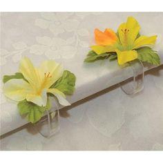Consejo Airedefiesta: Coloca estos Sujeta Manteles de Flores Hawaianas para que no se vuele la decoracion de tu mesa hawaiana. #ideasparafiestas #fiestahawaiana #decoracionenlamesa