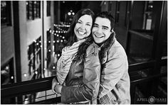 A cute couple is photographed in an urban alley environment with string lights hanging in downtown Denver Colorado during winter. - April O'Hare Photography http://www.apriloharephotography.com #WinterEngagement #DowntownDenver #DenverEngagement #ColoradoEngagement #DenverWinterEngagement #LarimerSquareDenver #DenverPhotographer #ColoradoPhotographer #LarimerSquare #OutdoorCafeLights #UrbanEngagement #StringLights #AlleyEngagementPhoto