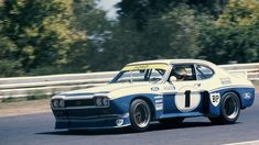 Robert Davies captures Alan Moffat is his Ford 'Cologne Capri' exiting 'Dandy Road' upon its Australian debut, at the Sandown Tasman meeting February Whi… Ford Mustang 1969, Ford Gt, Road Race Car, Race Cars, Ford Motorsport, Ford Granada, Sport Cars, Motor Sport, Aussie Muscle Cars