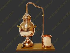 """Curious about making your own moonshine, but you don't live in Appalachia? The Iberian Coppers S.A. company (Portugal) will sell you a fully functional desktop-size copper whiskey still. And the price is fairly reasonable: this 2.5 liter """"Alembic Premium"""" model sells for about $220 (shipping to the U.S. included). I want one!"""