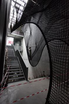 "Numen/For Use combines ""height and wobbliness"" in net staircase for Linz gallery"