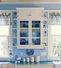 love the white cabinets with blue glass and walls.....maybe future kitchen