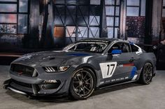 Ford Mustang GT4 race car front three quarters
