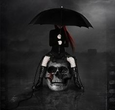 #Goth girl on Skull seat with over-sized umbrella.