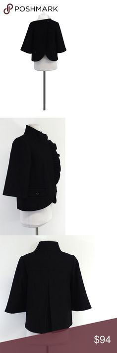 """Tibi- Cropped Black Wool Jacket Sz 2 This cropped jacket features a cute ruffled front. Pair it with a plain white top and colorful statement necklace for a fun professional look. Size 2 Shell 80% virgin wool 20% polyamide Lining 100% acetate Concealed buttons down front Decorative flap over button hip pockets Comes w/extra button Shoulder to shoulder 14.5"""" Sleeve length 16"""" Bust 34"""" Shoulder to hem 22.5"""" With this brand you will find bold, statement garments. Attention to detail and fit…"""