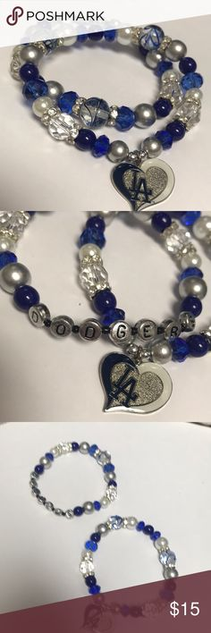 ⚾️Dodgers Baseball Bracelets 💙 Set of 2 bracelets made with high quality beads and crystals and LA dodgers heart charm.   This bracelet measures at about 8.5 inches and was made to fit on a larger wrist.   Stretch cord NEW, never worn Jewelry Bracelets
