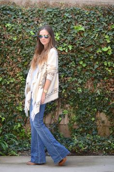 Don't let skinny jeans rule the world just yet! Bootcut Jeans are flattering for every body type, and so fun to style. 4 easy tips to styling them!