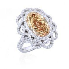 Of superb color and design...an 8.42 carat total weight, GIA certified, fancy brown orange oval diamond ring, mounted in 18K white and rose gold. The setting is styled with an interweaving pave-set motif. Truly one of a kind.  For more information about this item please contact our customer service department.