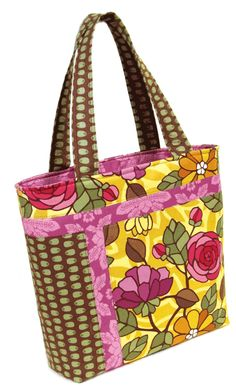 """This pattern, required for our Carnelian Bay, Crystal Bay Zen, Zephyr Cove, and Alpine Flower Tote Bag Kits, by Pink Sands Beach Designs with this Easy & Fun to Sew, No Sag Bottom, and Convenient Tote! A quick and easy gift, this tote will go together so quick, you'll want to make several!    The tote measures 15 1/2"""" wide at the top x 12 1/2"""" tall x 4"""" deep.  Six interior pockets for your convenience, and the handles can be customized for length."""