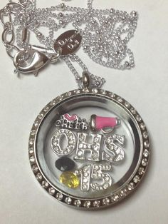 CHEER LOCKET With YEAR! Origami Owl Living Lockets tell a story - What is your story? Come check out all the fun at our website www.sabrinauntangled.origamiowl.com Designer# 37146