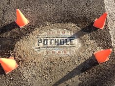 Pothole art.  Chicago Artist Mends Potholes with Mosaics.... the work of Jim Bachor.
