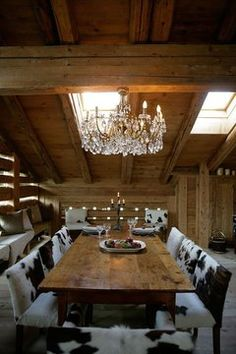 Rustic dining at its finest - wooden table and cowhide chair seating. My French Country Home, French Country House, Home, Rustic Cabin, Cowhide Decor, Rustic Furniture, Cowhide Chair, Western Home Decor, Rustic House