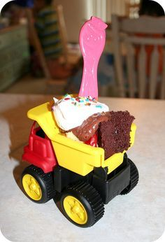 Construction / Truck theme party ~ serve birthday cake in cute little dump trucks.