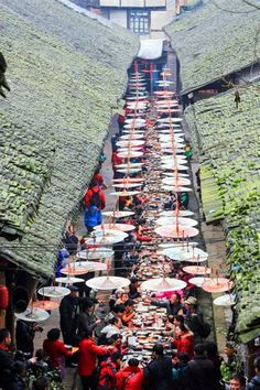 Xijiang, Guizhou Province 贵州西江, street banquet. via Discover China