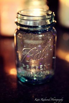 Mason Jar with glitter ~add soy wax fabulous tealight and you have the perfect wedding decor. Original idea by fs vintage & Kate Redmond Photgraphy