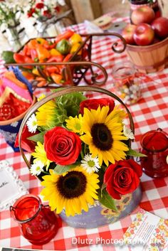Rustic wedding:  Among my collection of rustic containers that I rent is this fabulous sunflower tin filled with red roses and mini-sunflowers.  Please contact me for info about containers, rentals, and linens at WhimsicalWelcomes@yahoo.com