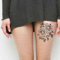 Elegant black lines flowers tattoo on thigh for women