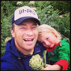 """@Jamie Wise Oliver's photo: """"picking my own Artichokes in UK With my boy buddy who for some reason is dressed as an elf ???!!!! We probably look very strange now buddy is chewing fennel herbs like chewing gum"""""""
