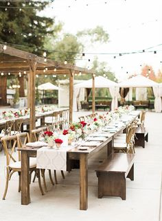 Dreamy Outdoor Rehearsal Dinner wedding inspiration with red flowers, twinkle lights, and cream linens - Inspired by This