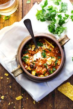 This 30 Minute Spicy Ancho Turkey Chili is super simple to make and includes ground turkey, tomatoes, black beans, and lots of spice. #healthy #soup #recipe #dinner #chili | pinchofyum.com