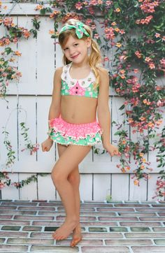 Make a splash this summer in this cheery and bright two piece swimsuit. This swimsuit is made with green and hot pink floral and bow printed woven fabric and is lined for swim. The top has halter neck Toddler Swimsuits, Best Swimsuits, Two Piece Swimsuits, Kids Fashion Show, Tween Fashion, Girl Fashion, Baby Swimsuit, Young Models, Child Models