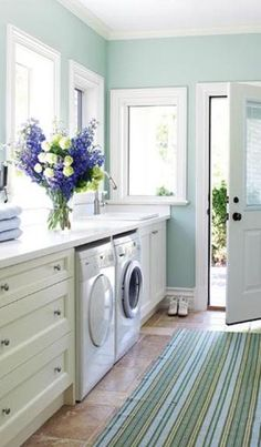 """Your laundry room should be a clean and peaceful oasis."" OMG! Why? Why should my laundry room be ""clean and peaceful""? Give me a break! I am tired of buying into this shit-  that I should enjoy housework!  Come on! Fresh flowers in my laundry room? Barf! That's like a $200 bouquet! Ugh!"