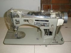 A Necchi BU Supernova. This particular machine had holes cut in the casting and clear plastic Top Cover and Face Plate. This Machine was taken to Trade Shows to show to dealers. The BU Supernova was the first Necchi to feature 'cam's. Cams could be loaded in the top of the machine for decorative stitching.