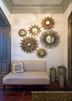 Simone Design Blog: Decorating with Sunburst Mirrors. Neat idea for an entryway or offset wall.