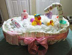"DIY Baby Bath Tub Diaper Cake         Materials:    35 diapers + 21 extras 1-baby bath tub 1-baby bath gel 1-baby powder 1-baby lotion 2-teething rings 2-baby wash cloths 1-Sm rubber ducky that takes the waters temperature 1-lg rubber ducky that covers the tub's water spout a little poly foam &  2"" wired ribbon"