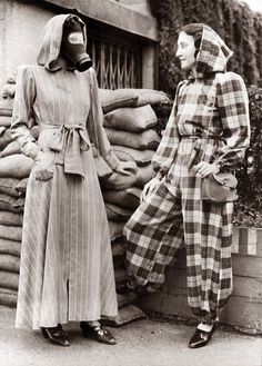 London, England Sept 14, 1939. The very latest fashion in air raid shelter wear is a slip on dressing gown complete with hood, and can be left open, (left), or zipped into trousers, (right). (via)