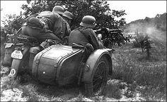 A motorcycle reconnaissance team firing their machine gun at a enemy position