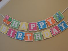 Candy land inspired birthday banner. Bright colored happy birthday banner with lollipops and gumball machine.