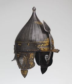 The Met - Helmet 1560.  This helmet is from the 15th century and originated from Istanbul. The culture this helmet aspired from is Turkish, most likely Istanbul. It consists of watered steel which is decorated with gold Koranic expressions and arabesques. There is a similar helmet to this one currently at Kunsthistorisches Museum located in Vienna.