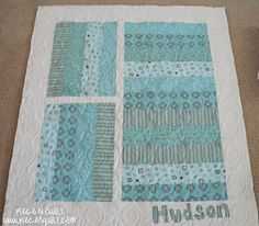 A simple baby boy quilt. This would be perfect to make in matching colors with each of my boys names on it.