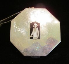 This is a very rare and lovely vintage 1920's Art Deco sterling silver compact dance purse with a silver mesh wristlet chain, and enamel flapper golfer graphics. The octagon shaped piece is in wonderf