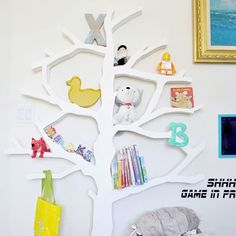 Learn how to make a tree shaped bookshelf! Video included! (via The Design Confidential)