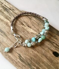 This beautifully detailed bracelet is made with many natural materials consisting of natural Agate nugget gemstone beads with 6mm round Jasper beads, crystal rondelle beads and Silver spacer beads throughout. A braided antique gray braided leather cord adds texture and style! Just