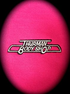 Thurman Body Shop. From crashes to dings they can fix almost anything.  Love this left chest logo on the pink.  Embroidery by Top It Off.