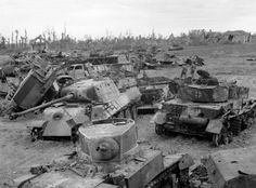 Mix if German & American vehicles in a scrap-yard near Caen. 1944